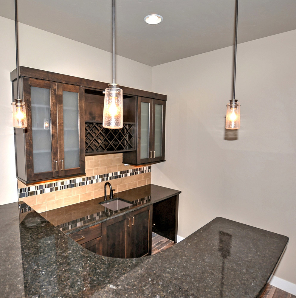 Basement wet bar lighting and bar top