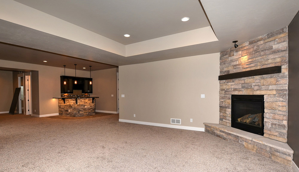 Basement wet bar and fireplace